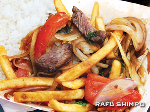Lomo Saltado—marinated beef, stir-fried with sliced tomatoes, onions, and potatoes.