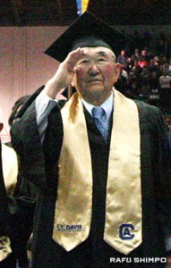 Frank Inami salutes during the National Anthem on Saturday during the commencement.