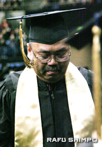 Henry Marubashi, Jr. tears up as he receives the degree for his late father, Henry Sr.