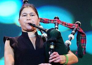 Isabel plays bagpipes last fall in Sendai. She took up the instrument after her transplant to celebrate her newly-given lung power. (Courtesy Isabel Stenzel)