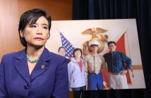 Rep. Judy Chu with a photo of her nephew, Lance Cpl. Harry Lew, and his family.