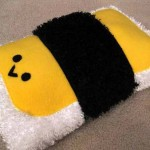 Hugging a plush musubi pillow can help make the world seem all warm and cuddly. (Nancym4)