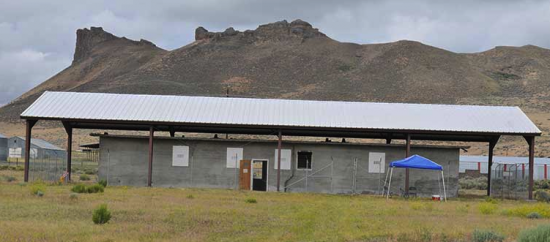 The Tule Lake Committee is working on the restoration of the segregation center's jail, pictured in 2012. In the background is Castle Rock. (Photo by Kiyoshi Ina)