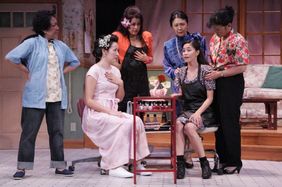 "New to town, Annelle (Lovelle Liquigan, center) sheds some light on her past with the ladies of Truvy's salon in East West Players' ""Steel Magnolias"" From left: Karen Huie, Ruth Coughlin, Hiwa Bourne, Dian Kobayashi, Liquigan, Patti Yasutake. (Photo by Michael Lamont)"
