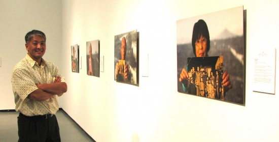 Darrell Miho with some of his portraits of hibakusha.