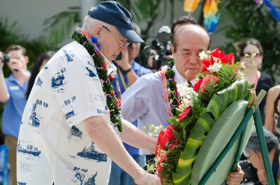 Lauren Bruner, USS Arizona Survivor, and Masahiro Sasaki, brother of Sadako Sasaki, lay a memorial wreath in front of the Tree of Life at World War II Valor in the Pacific National Monument at Pearl Harbor during the Sadako Crane exhibit unveiling. (Pacific Historic Parks)