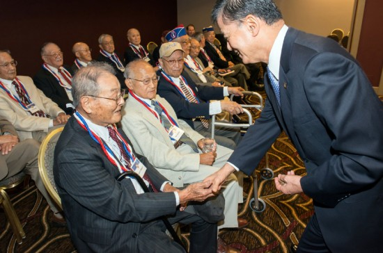 Veterans Affairs Secretary Eric Shinseki meets with Nisei veterans at the opening of the Congressional Gold Medal exhibition in Portland, Ore.