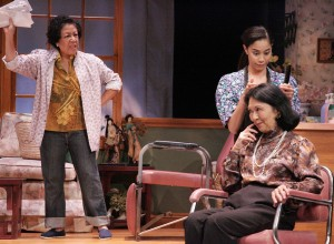 "In a scene from ""Steel Magnolias,"" Annelle (Lovelle Liquigan) does Clairee's (Dian Kobayashi) hair while Ouiser (Karen Huie) complains about church mailings she has been receiving. (Photo by Michael Lamont)"