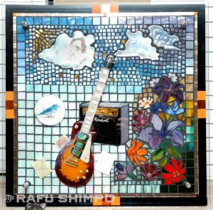 Ishida's tribute to her brother, Roy, features his Gibson guitar, Beatles sheet music and bead work of a blue jay he used to feed at this house.