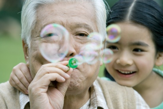 A Nikkei senior enjoys spending time with his granddaughter.