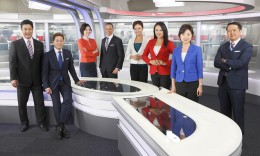 "The anchor team of NHK'S Newsline,"" from left: Ross Mihara, Raja Pradhan, Ai Uchida, Ron Madison, Sherry Ahn, Catherine Kobayashi, Yuko Aotani and Gene Otani. (Courtesy KCET/NHK)"