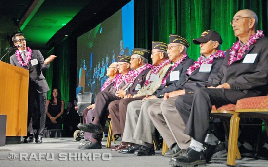 Emcee David Ono welcomes Nisei World War II veterans to the stage.