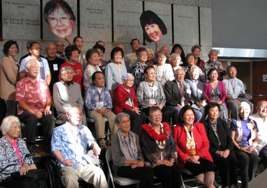 Nancy Araki (front row with Sumi Hirasaki and Irene Hirano Inouye) is joined by staff members, volunteers and supporters who were with the museum before 1994.