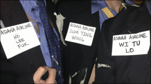 Three men wore Asiana-themed costumes with prank names from a KTVU broadcast.