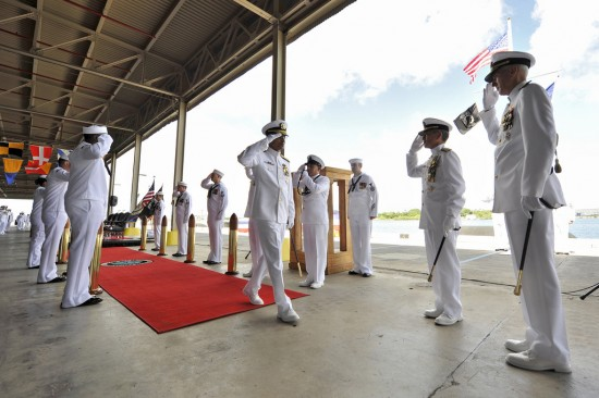 Adm. Cecil D. Haney passes through the side boys after being relieved by Adm. Harry B. Harris Jr., commander of U.S. Pacific Fleet, during a change-of-command ceremony on the Pearl Harbor waterfront. (U.S. Navy photo by Mass Communication Specialist Seaman Johans Chavarro)