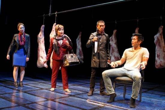 """An unlikely family reunion inside a meat locker. From left: Jackie Chung, Emily Kuroda, Lawrence Kao and Nelson Lee in South Coast Repertory's 2013 world premiere production of """"Fast Company"""" by Carla Ching. (Photo by Debora Robinson/SCR)"""