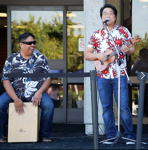 Jason Arimoto (right) performs with Brad Ranola at the Gardena Heritage Festival last Saturday. (Photo by Steve Awakuni)