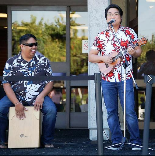 Jason Arimoto (right) performs with Brad Ranola at the Gardena Heritage Festival last Saturday. (Photo by Steve Awakuni)