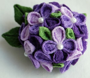 Wendy Lee of Playa Del Rey crafted a kanzashi hydrangea pin in shades of purple using tarched fabric. (Courtesy of Wendy's Origami)