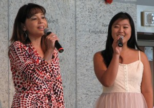 "Helen Ota and Miko Shudo sing ""American Made."""