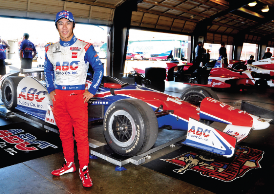 Takuma Sato poses with his car at the Auto Club Speedway on Sept. 24. He'll be back in Fontana on Oct. 19 for the American Real 500. (Photo by Tim Yuji Yamamoto)