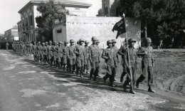 Company H, 442nd Regimental Combat Team, marches through a recently liberated town in Italy. The 442nd RCT captured and liberated numerous towns in Italy and in Southern France. (National Archives)