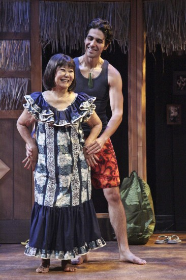 "Takayo Fischer as Sumi and Tui Asau as Kimo practice ""lovely hula hands."" (Photo by Michael Lamont)"