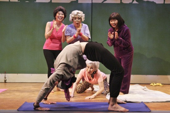 "The Nisei Widows are amazed at yoga teacher Patrick's bridge pose. From left: Jeanne Sakata as Tomi, Tui Asau as Patarick, Emily Kuroda as Hana, June Kyoko Lu as Betty, and Takayo Fischer as Sumi in East West Players' ""The Nisei Widows Club: How Tomi Got Her Groove Back."" (Photo by Michael Lamont)"