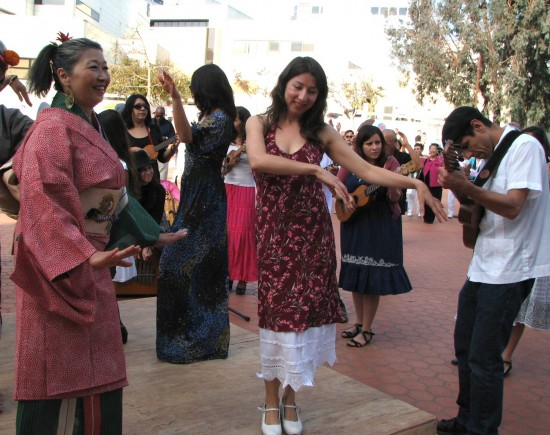 "Two cultural traditions merged on Nov. 3 in Little Tokyo as Great Leap and the Chicano band Quetzal presented ""FandangObon."" Members of the Japanese American and Mexican American communities gathered in the JACCC Plaza to learn each other's dances and music, and combine them."