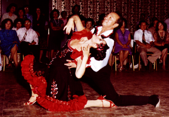 Harry Kanada performs the rumba with Sheila Sloan at his 13th anniversary dance on April 10, 1982 at the Proud Bird Restaurant.