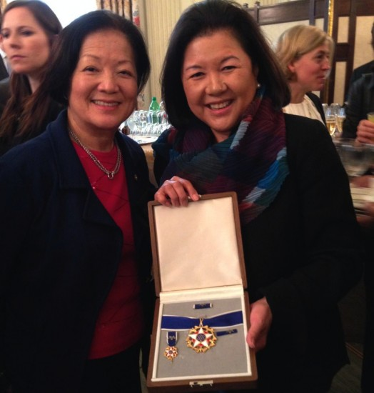 Irene Hirano Inouye holds up the Presidential Medal of Freedom she accepted on behalf of her late husband, Sen. Daniel Inouye. She is pictured with Sen. Mazie Hirono.