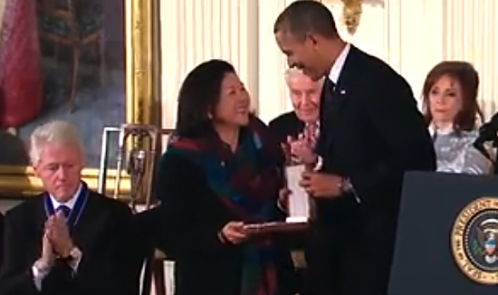 Irene Hirano Inouye receives her late husband's Presidential Medal of Freedom from President Obama. Pictured behind them are former President Bill Clinton, former Sen. Richard Lugar, and country music legend Loretta Lynn. (Whitehouse.gov)