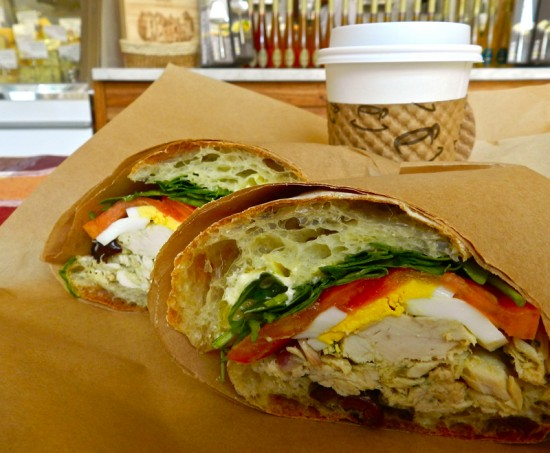 One tempting nicoise sandwich and cuppa joe to go.