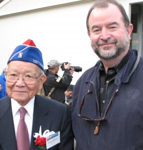 Terry Shima of the Japanese American Veterans Association and photographer Tom Graves, whose portraits of Nisei veterans are on display in the MIS Historic Learning Center.