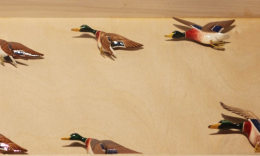 Above and below: Examples of hand-painted birds by Wayne Masato Sumida.