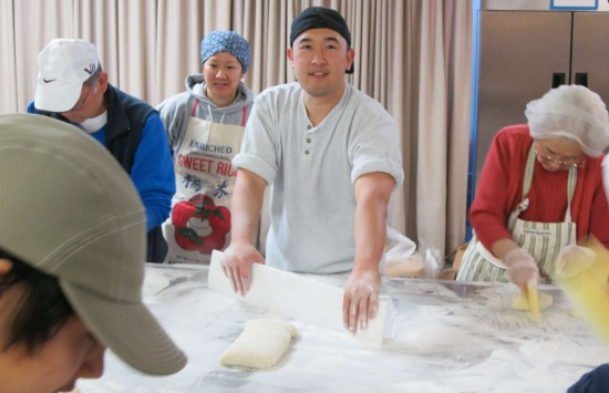 Fresh mochi is cut into chunks, which in turn are rounded into smaller pieces.