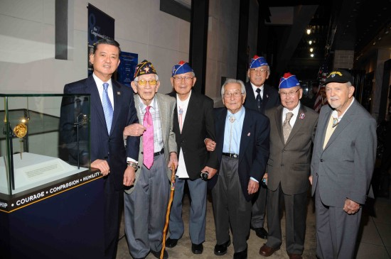 """U.S. Secretary of Veterans Affairs Eric Shinseki with World War II veterans of the 100th, 442nd and 36th Division in front of the """"American Heroes: Japanese American World War II Nisei Soldiers and the Congressional Gold Medal"""" exhibit at the Holocaust Museum. Veterans shown left to right: George Fujimoto (442), Nelson Akagi (442), Susumu Ito (442), Lawson Sakai (442), Tommie Okabayashi (442), Robert Pieser (36th). (Photo by Kris Ikejiri)"""
