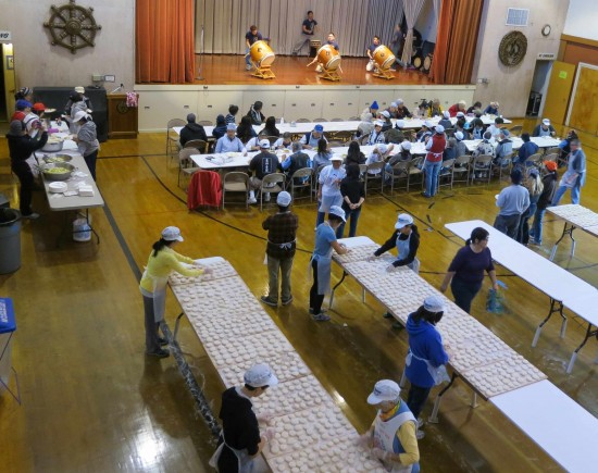 As San Jose Taiko performs on the stage, volunteers flip mochi at the San Jose Betsuin Annex.