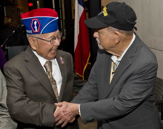 World War II veterans Tommie Okabayashi of Houston, left, and Texas 36th serviceman Robert Peiser of Harlingen, Texas reunited during the opening ceremony of the Congressional Gold Medal Exhibit at Holocaust Museum Houston on Thursday. (Photo by Tom Shea)
