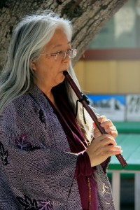 Aiko Kurland plays the flute during the ceremony.
