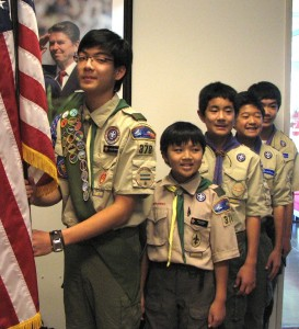 Boy Scouts from Troop 378 prepare to post the colors.