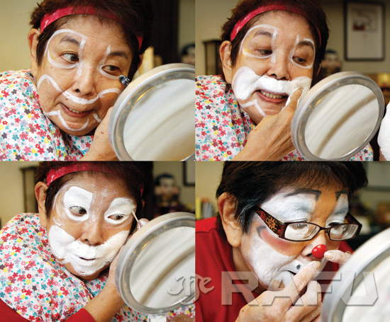 """Hironaka applies makeup to transform into Tiny Bubble. """"It's such a wonderful thing to make people laugh,"""" she says."""