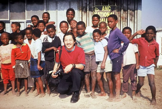 Mike Murase in a shanty-town in Natal Province, South Africa in 1991, with young supporters of the African National Congress.