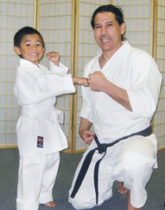 This photo from the Kaizen Dojo website shows Sensei Ford with one of his young pupils.