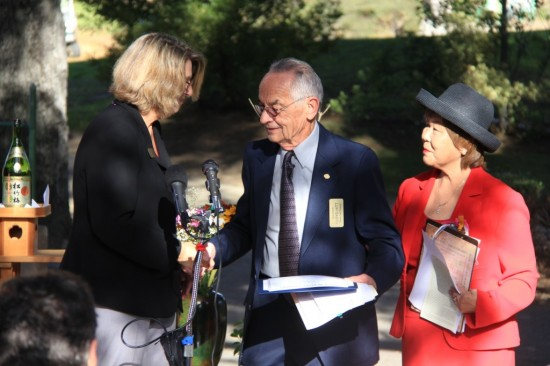 On behalf of Rep. Adam Schiff, Teresa Lamb Simpson presents a commendation to Lloyd Hitt and Nancy Oda of the Tuna Canyon Detention Station Coalition.