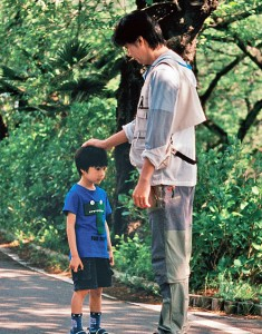 Keita (Keita Ninomiya) gets some much-needed reassurance from the man he has known all his young life as his father, Ryota, played by Masaharu Fukuyama. (IFC Films)