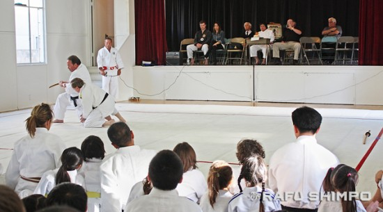 As students and guests watch, Alan Wilkinson and Einhard Schmidt perform the kime no kata, forms of decision, during the Kagami-Biraki at the Sawtelle Judo Dojo. (GWEN MURANAKA/Rafu Shimpo)