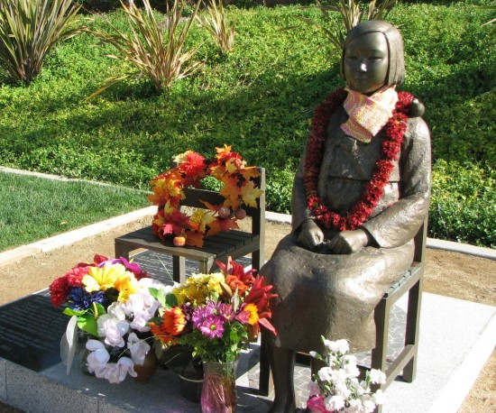 The comfort women memorial in Glendale, pictured in November, is decorated with flowers. (J.K. YAMAMOTO/Rafu Shimpo)