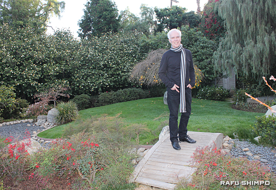Gil Garcetti on a bridge in his Japanese garden, which includes camellias and Japanese red pines. (JUNKO YOSHIDA/Rafu Shimpo)
