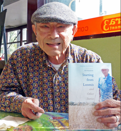"Hiroshi Kashiwagi holds a copy of his new memoir, ""Starting from Loomis."" Kashiwagi writes on his experiences growing up in the small farming town of Loomis, and also his decision to answer ""no-no"" on the loyalty questionnaire. (Photo by Ben Arikawa)"